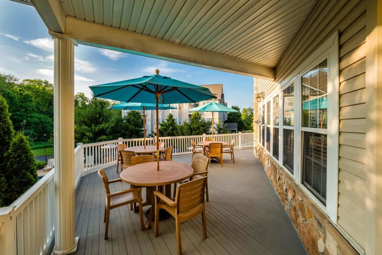 Saucon View clubhouse deck overlooking swimming pool and lush greenery in Bethlehem