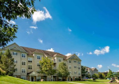 Wide shot of Saucon View with pictureque apartment rentals and fields on beautiful day in Bethlehem, PA