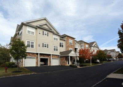 Exterior of Saucon View apartments for rent in Bethlehem, PA with spacious private garages on sunny day