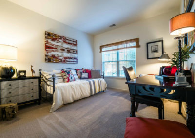 Spectacular model bedroom with carpeted flooring and medium-sized window in Saucon View apartments