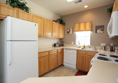Spacious kitchen with wooden cabinets and white appliances in Bethlehem, PA apartment