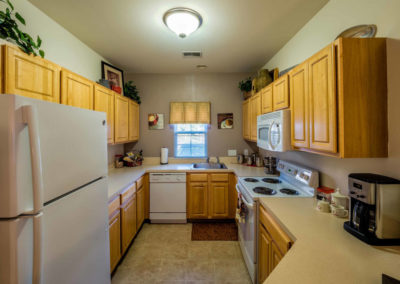 Large kitchen with wooden cabinets and white appliances at Saucon View apartments