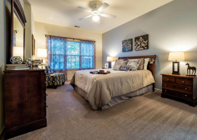 Spacious carpeted bedroom with large windows in Saucon View apartment rentals in Bethlehem, PA