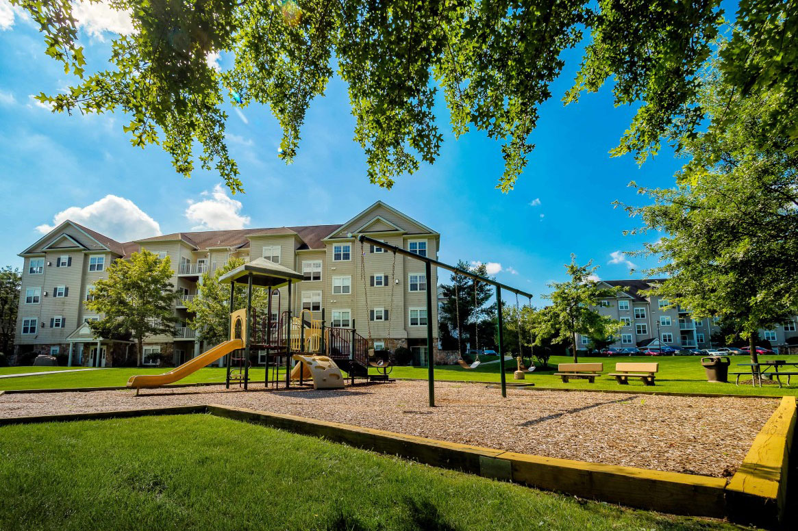 Child-friendly playground with spacious field for residents on Saucon View apartment grounds in Bethlehem, PA
