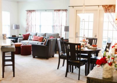 Another angle of dining room with spacious living room and large windows in Saucon View apartment rentals Bethlehem, PA
