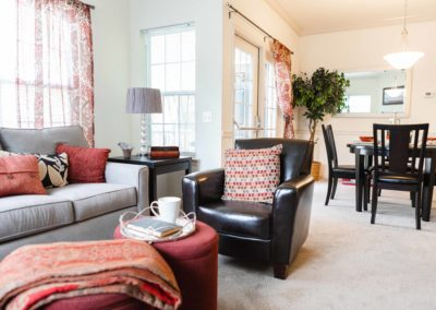 Lovely living room with open dining room floor layout for conveience in Saucon View apartments
