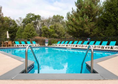 Exclusive swimming pool with sun deck as community amenity for Bethlehem, PA apartment residents