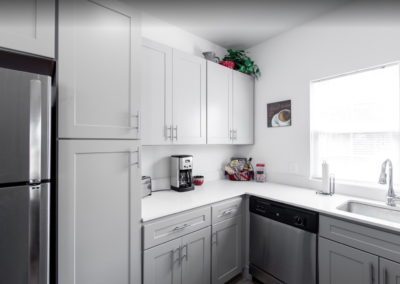 Stellar furnished kitchen space with white cabinetry in Saucon View apartments for rent in Bethlehem, PA